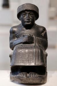 Seating diorite statue of Gudea, prince of Lagash, dedicated to the god Ningishzida, c. 2120 BC (neo-Sumerian period). Excavated in Telloh (ancient Girsu), Iraq. Louvre Museum