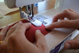 On a scrap piece of fabric, make a sample buttonhole that fits the buttons you will be using in your project.