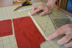 Fold the freezer paper strip in half along the center line.